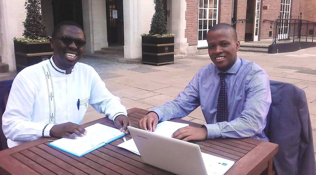Professor Mayosi (left) is interviewed by the UCT UK Trust website's Thapelo Moloantoa on one of his visits to London.